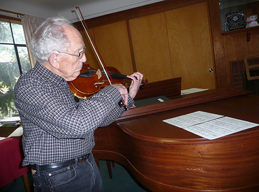 Frank Holman expects to have more time to play his violin in retirement, after 40 years as music director at Rose City Park United Methodist Church. He retired as a public school music teacher in 1988. (Janet Goetze)