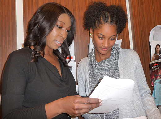 Sherree Thomas-Coleman, left, Benson High School's college coordinator, points out scholarship possibilities for Kemle Fakhry, a senior considering majors in communications or international law.  Kemle, whose family came from Senegal, also is looking at athletics programs. (Janet Goetze)