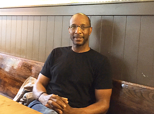 Kevin Shelby in his Alberta Street restaurant, Fuel. The comfortable space –which used to be a coffee shop only – is known for its locally sourced, organic comfort food, including gluten-free and vegan options. Shelby grew up just a few blocks away from where the restaurant now stands. (James Bash)