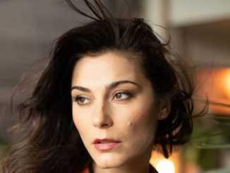 Elysia Rotaru with black hair and brown eyes