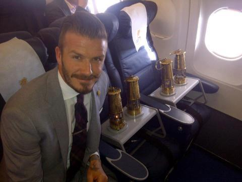 PHOTO David Beckham on a plane with the Olympic flame  starcasmnet