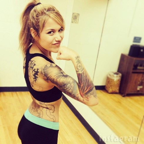 Tosca Yeager tattoo arm and back