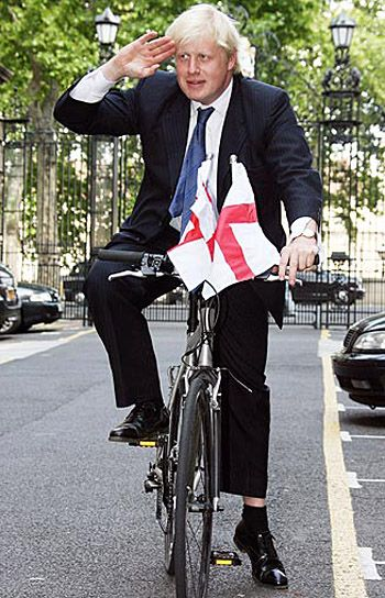 Boris Johnson on a bicycle with English flags
