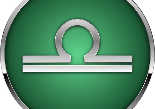 Libra glyph on green background