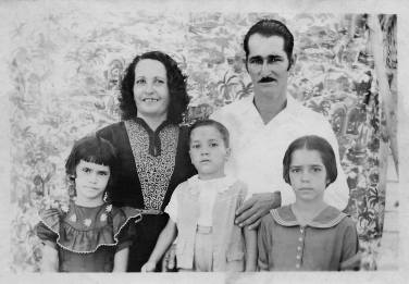 "1953 My great-grandparents - Ynocencia Natividad Peña Garcia, and Bernardo Pablo Viera Segui - and their children, my grandma - Minerva Anastasia Viera Peña - and my great-aunt and -uncle - Nilde Rufina Viera Peña and Clemente Emilio Viera Peña. The photo was taken September 20, 1953, in their estate, El Porvenir (The Coming), Manicaragua, Villa Clara, Cuba My great-grandfather wrote: ""With all my affection, for my uncle and aunt, Antonio and Ysabel, from their nephew Pablo, and family"""