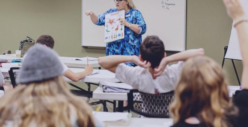 teacher speaking to her class