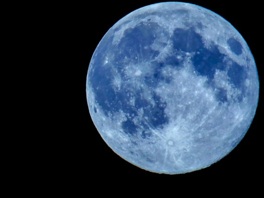 A blue moon tinted blue to make it look like the moon is actually blue. A blue moon means 2 full moons in a calendar month.