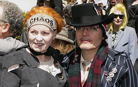 Vivienne Westwood wearing her Chaos headband with John Galliano