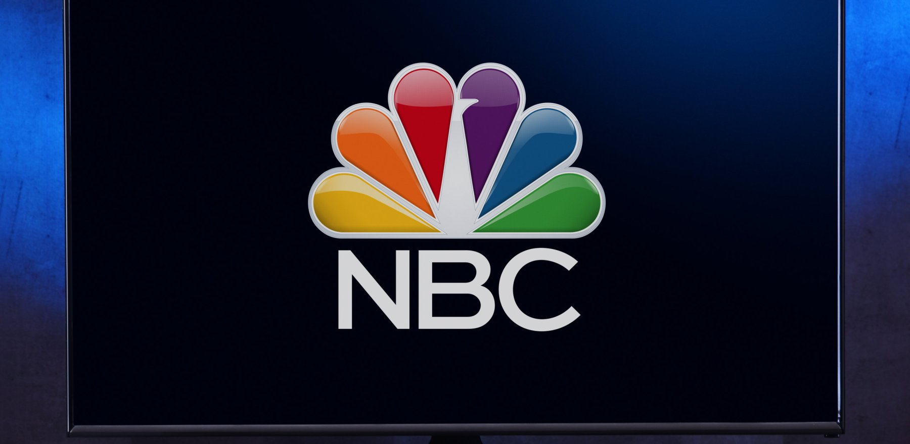 POZNAN, POL - FEB 04, 2020: Flat-screen TV set displaying logo of NBC, an American English-language commercial terrestrial radio and television network that is a flagship property of NBCUniversal