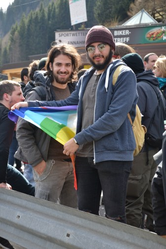 Two men with the peace flag