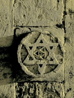 sodislamVery old Star of David on the Inner Wall of Jerusalem Old City.