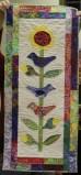 Judy Coffman - Birds on Sunflower applique quilt