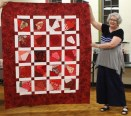 Kristin Farwig - crazy quilt top made with red crazy pieced blocks won at guild meeting and made by guild members. Thank you to everyone who made a block! I will be donating this quilt as a comfort quilt. It will be quilted by Ann Weaver.