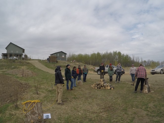 Participants gather for a wood chopping demo
