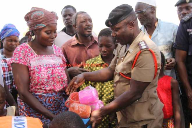 The displaced persons receive relief items from Ghanaian authorities