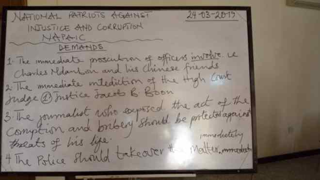 A board surfaced at the conference, highlighting NAPAIC's request for protection of Starr News' correspondent, Edward Adeti, among other demands.