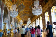 inside the infamous hall of mirrors, where gold leaf and crystal chandeliers abound!
