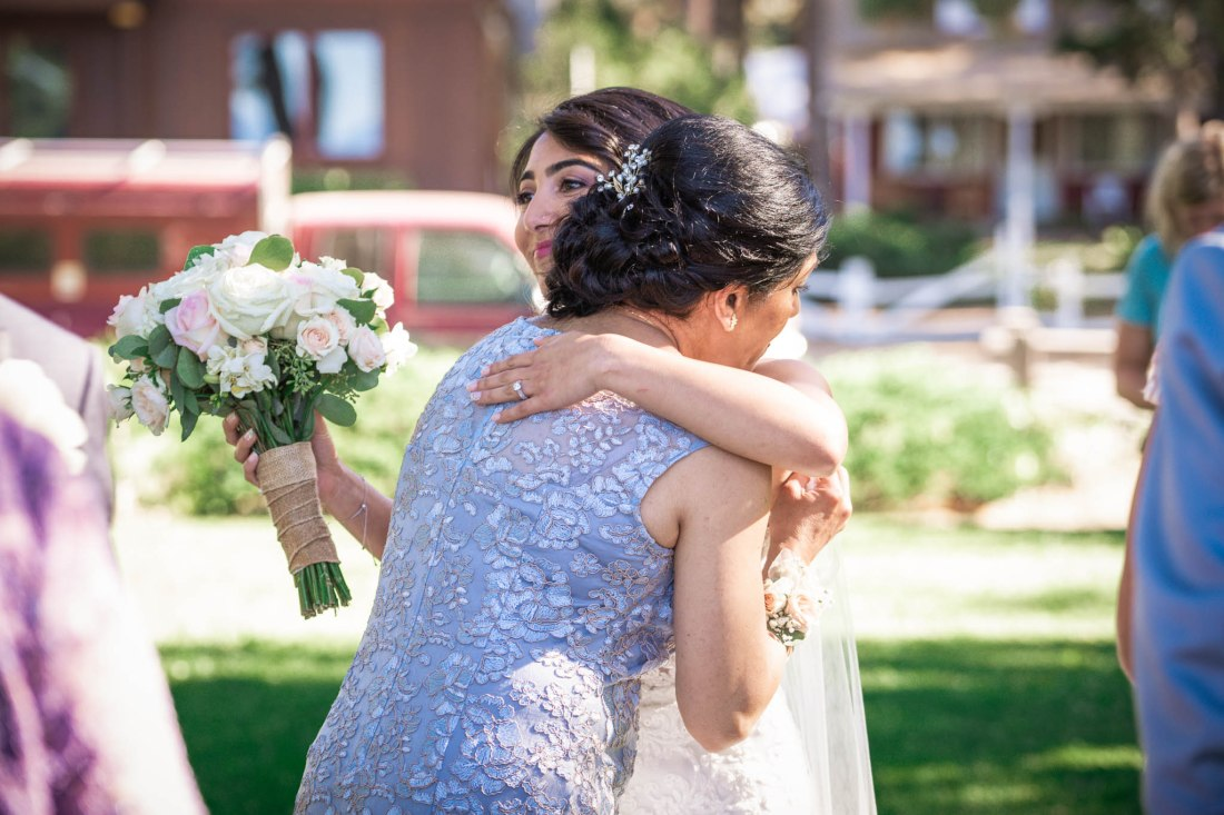 Bride's mother hugs her after the ceremony