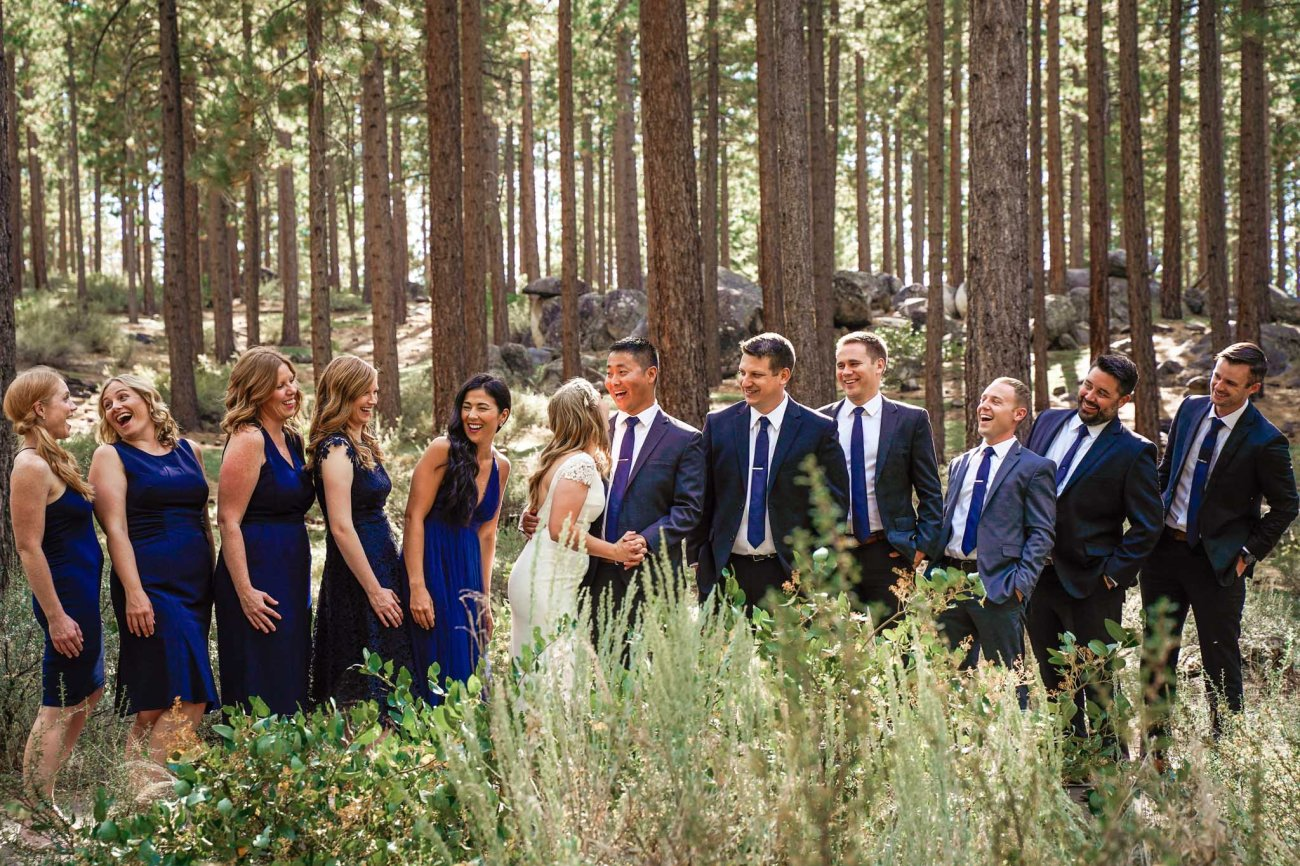 Wedding party laughing for their formal photographs