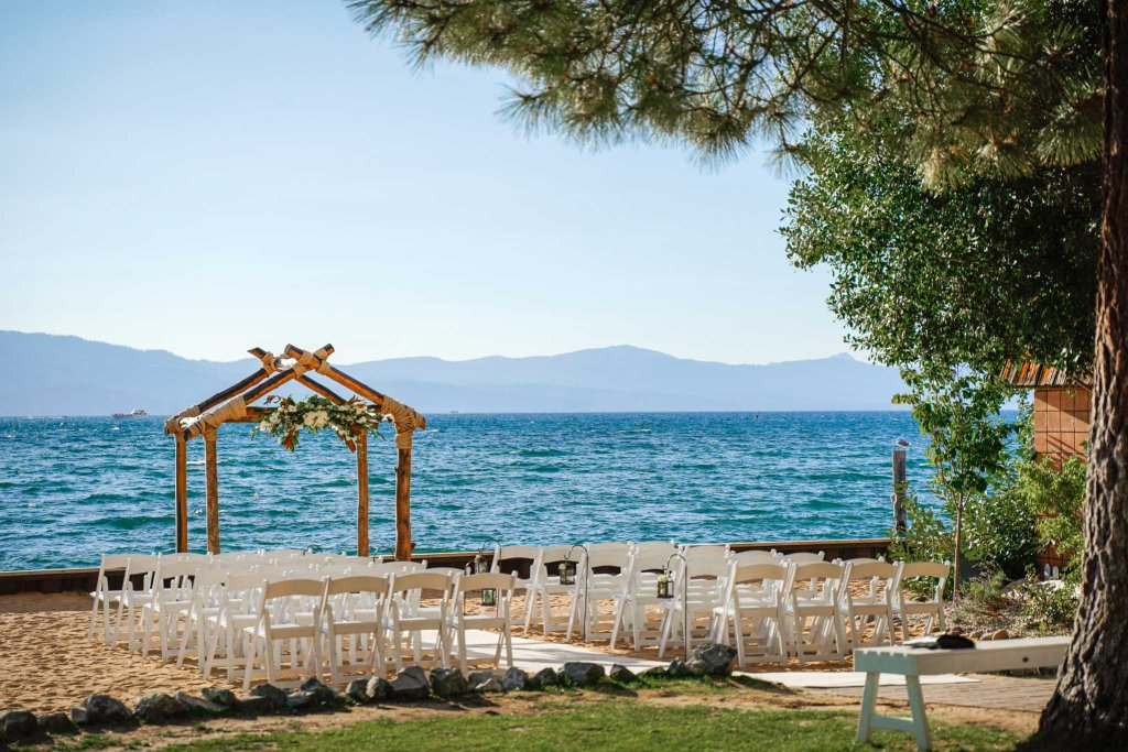 Lakeside Beach wedding setup with arch and chairs in South Lake Tahoe
