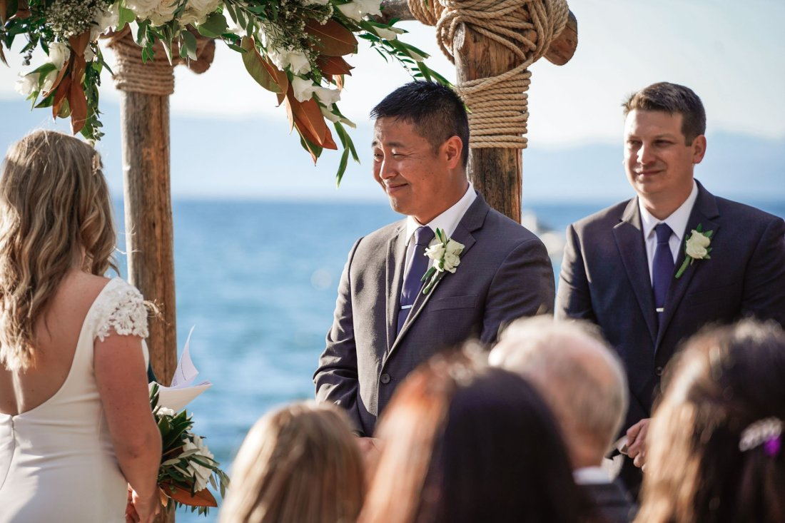 Groom sees his bride and tears up during wedding at Lakeside Beach in South Lake Tahoe