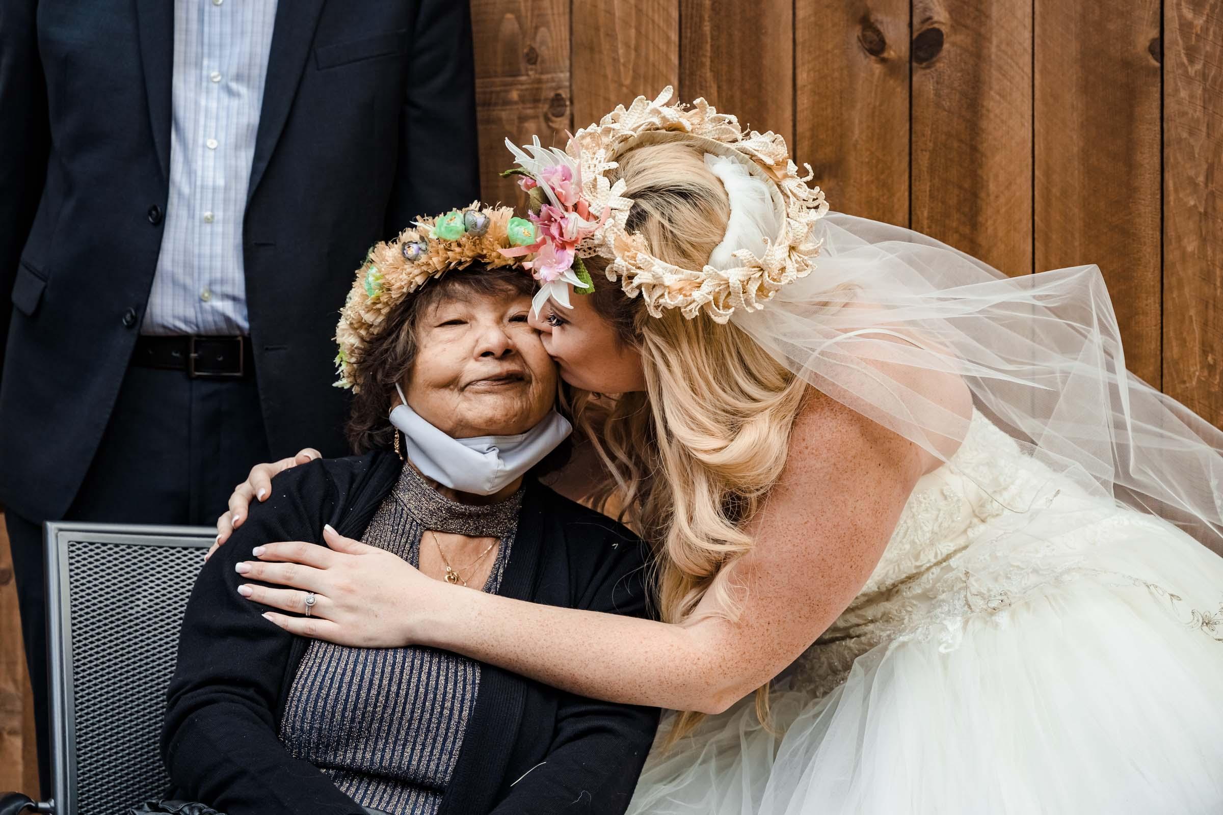 Bride kissing her grandmother