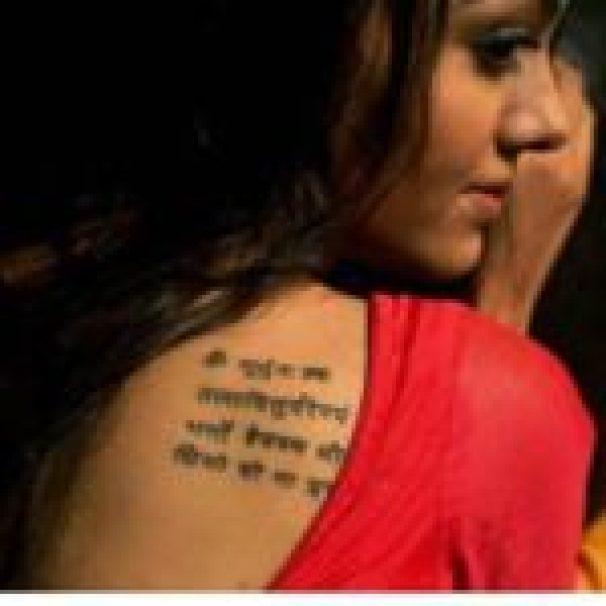 A Written Tattoo On The Shoulder Of Arina Dey