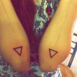 Flipped Triangles on Aarushi's elbows