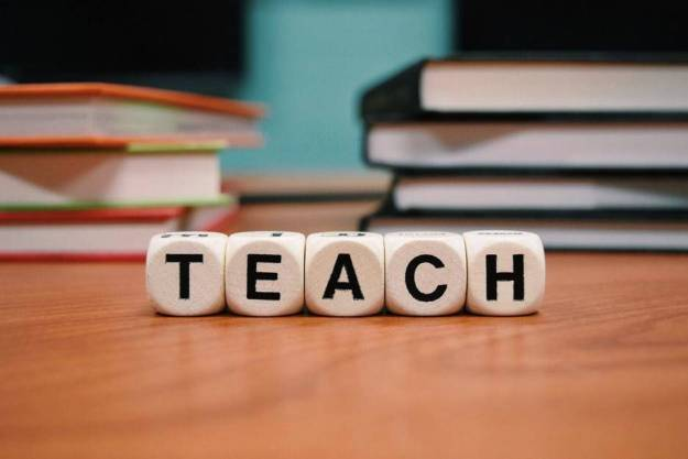 Letter blocks showing the word teach