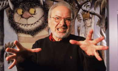 Author/illustrator Maurice Sendak standing by an life-size