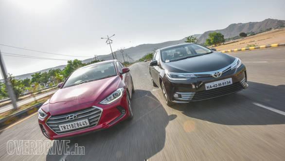 new corolla altis vs elantra interior all camry 2016 2017 toyota petrol automatic hyundai 2 5