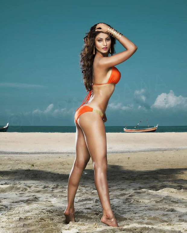 urvashi rautela flaunts her sexy curves in orange bikini - newsdezire