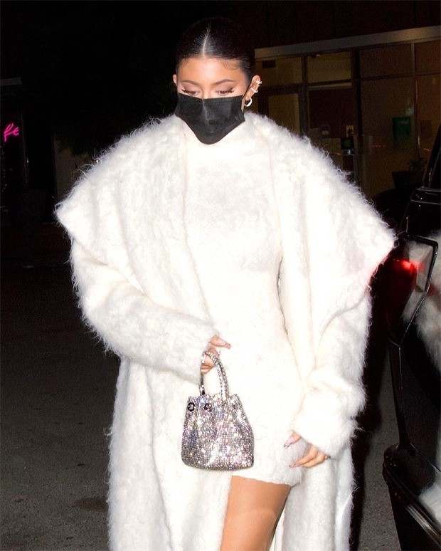 Kylie Jenner aces monotone look with fuzzy white bodycon & faux fur overcoat for dinner outing