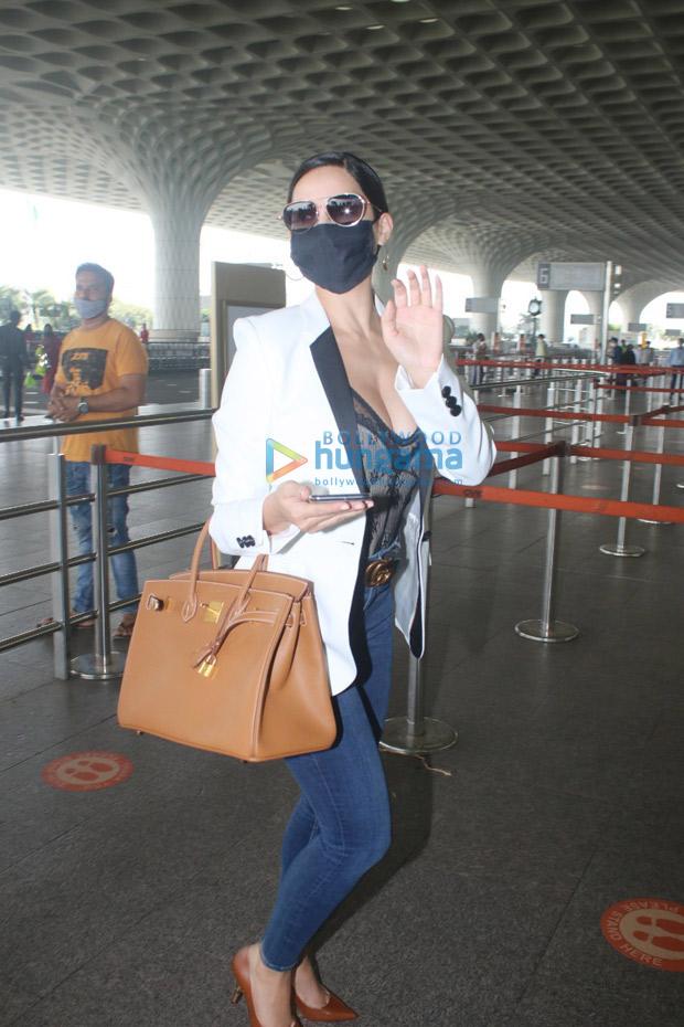 Nora Fatehi pairs semi sheer lacy corset with skinny denims, carries Hermès Birkin bag worth Rs. 7 lakhs : Bollywood News - Bollywood Hungama