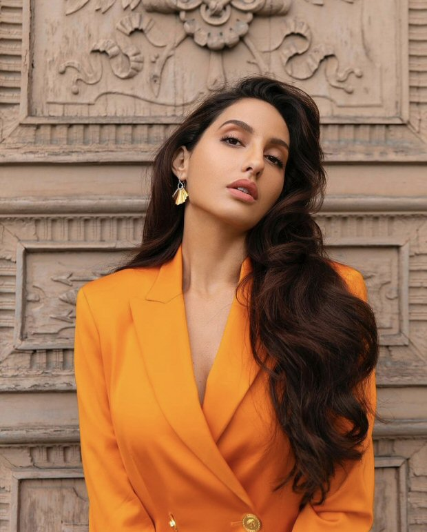 Nora Fatehi pairs orange Versace blazer worth 1.2 lakhs with shimmery pants and YSL bag worth Rs. 1.5 lakhs 4