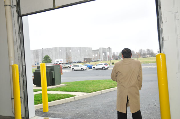Groundbreaking guest gazes at new Dermody warehouse in Logan Township, NJ. (Steve Lubetkin photo)
