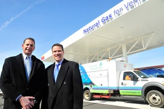 Celebrating the opening of Wawa's first compressed natural gas fueling station in Paulsboro, NJ are: Jeff DuBois, president, South Jersey Gas, and Brian Schaller, Wawa's vice president of fuel supply & retail operations. (Steve Lubetkin Photo/StateBroadcastNews.com)