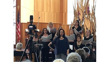 Cantor Sandra Messinger leads the Adath Emanu-El Women's Choir from Evesham Township, Burlington County, NJ, at the 52nd Annual Delaware Valley Jewish Choir Concert, at Temple Emanuel, Cherry Hill, NJ