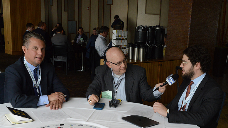 During the NAIOP I.CON conference in Jersey City, David Greek of F. Greek Development, right, responds to a question from GlobeSt.com correspondent Steve Lubetkin, while Matthew Marshall of Cushman & Wakefield, left, looks on. (NAIOP Photo/Gary Gellman, Gellman Images)