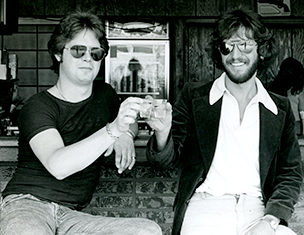 "Tony Pallagrosi, left, and Carlo Novi, toasting the announcement of their new group, ""The Main Street Shots,"" in June 1977 in Asbury Park, NJ. (Steve Lubetkin photo/Asbury Park Press)"