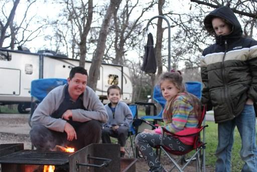 A family enjoying a camp fire