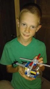 Boy holding Lego creation