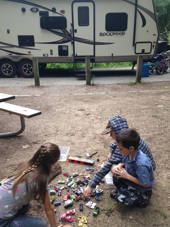 Kids playing with toy cars