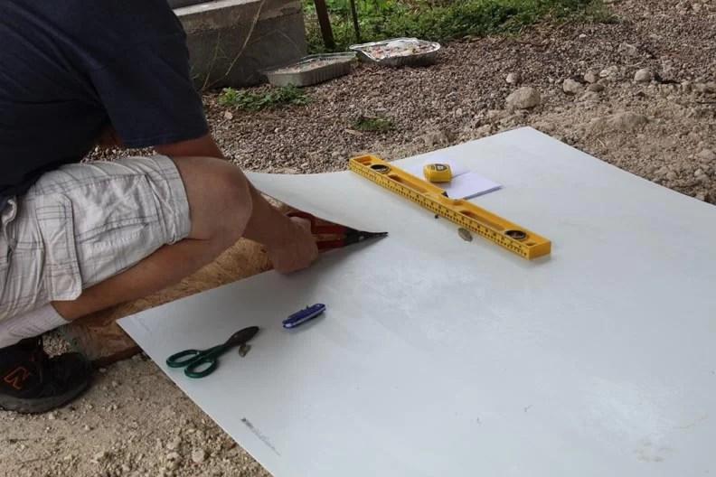 Man cutting fiberglass panel