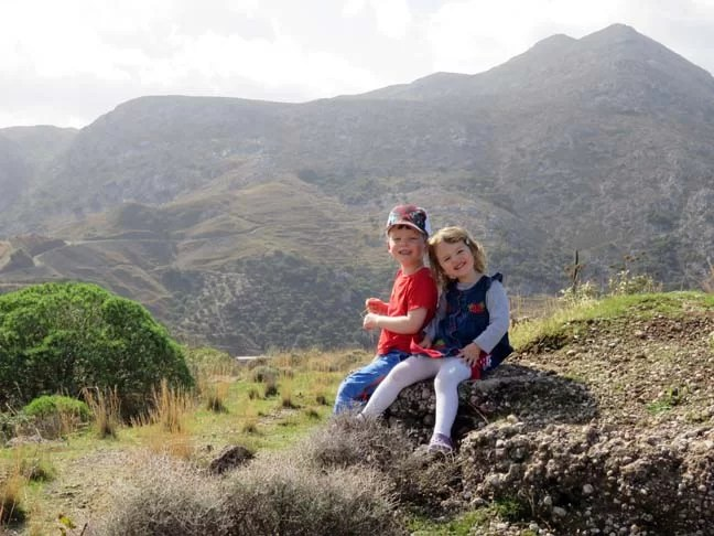 Two kids on a mountain top