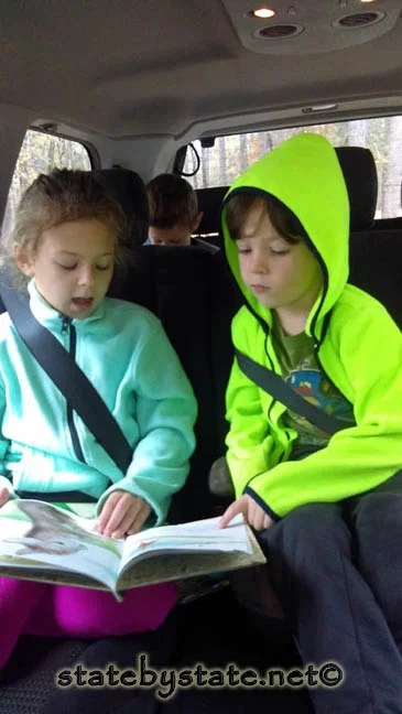 Boy and  a girl in the car during a road trip.