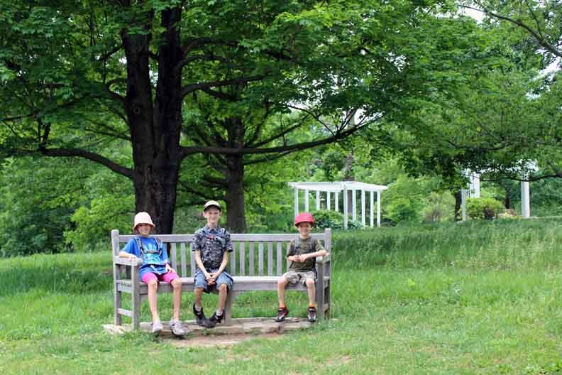 Three kids on a bench.