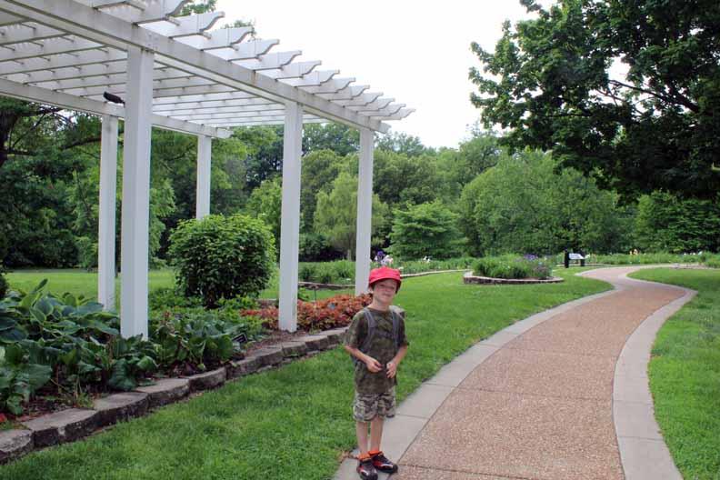 A boy next to a path.