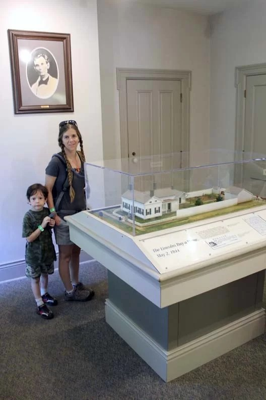 A boy and his mom in the museum.