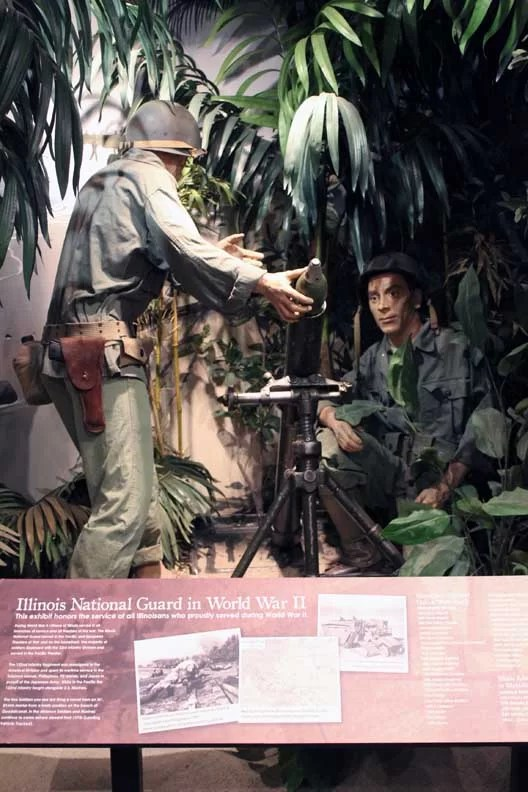 Wax statues operating a mortor.
